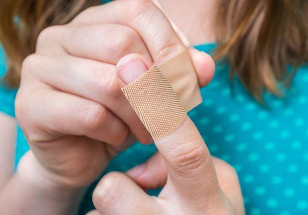 child with bandaged finger