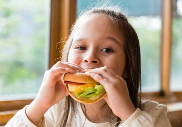 child eating messy burger