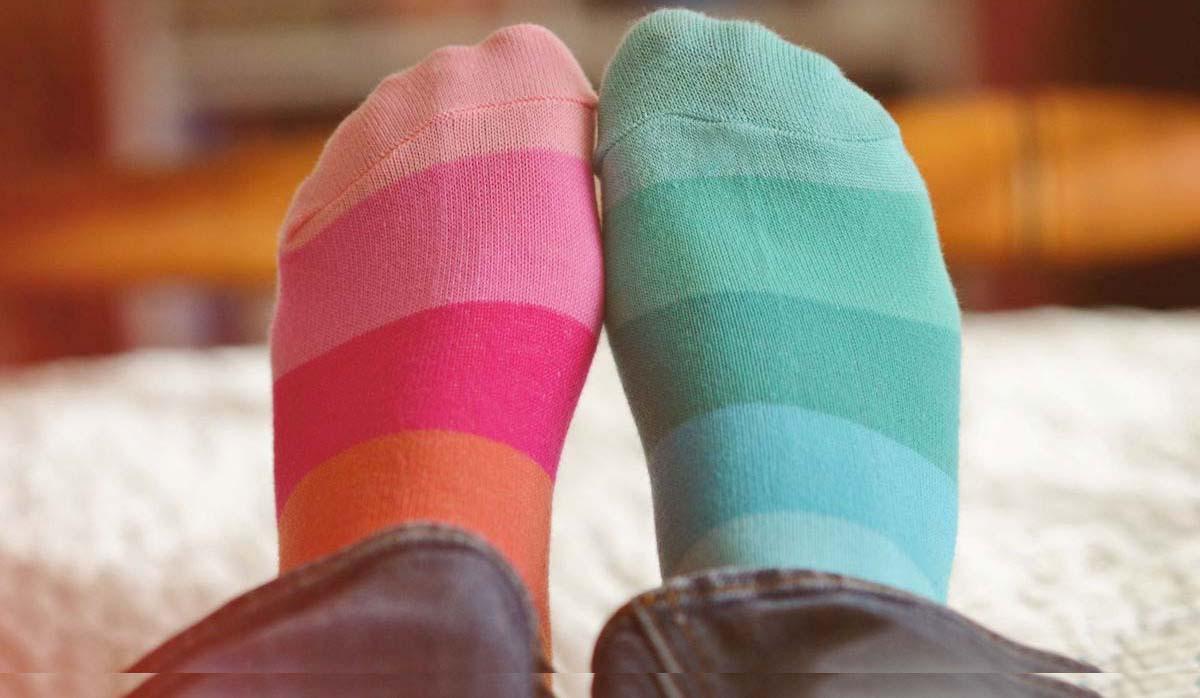 2 feet wearing socks that do not match
